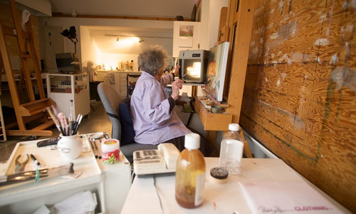 A photo of the late Mary Pratt at work in her studio