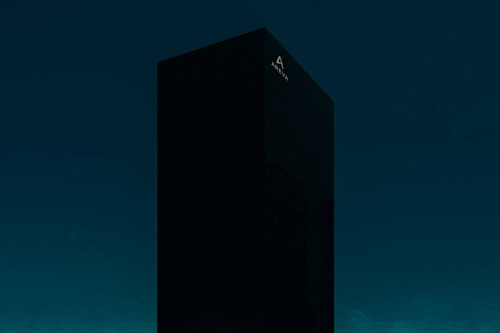 A photo of a skyscraper at night