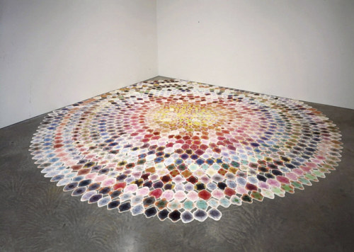 An installation with a spiral shape on a gallery floor