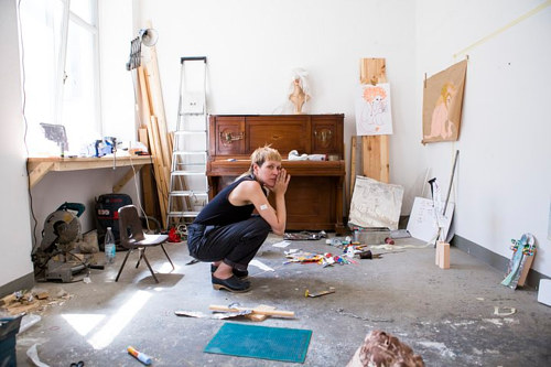 A photo of Jesse Darling working in their studio