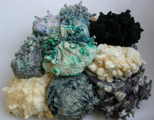 An artwork consisting of dyed and balled-up textiles