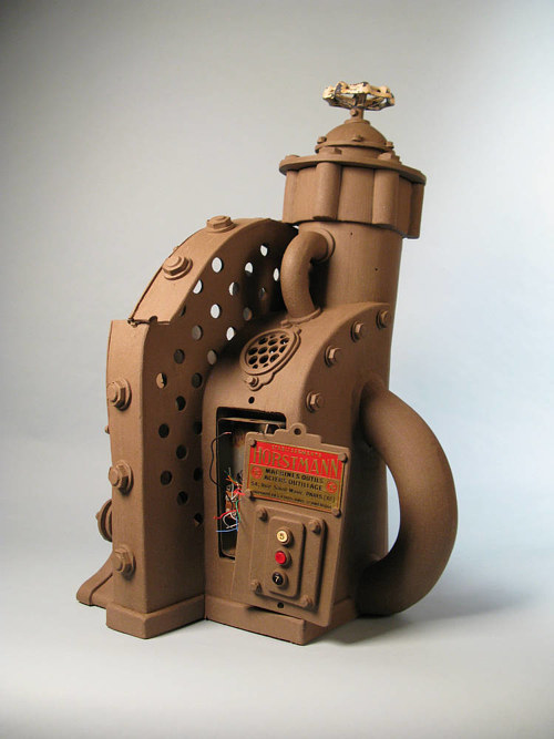 A clay sculpture of a strange machine