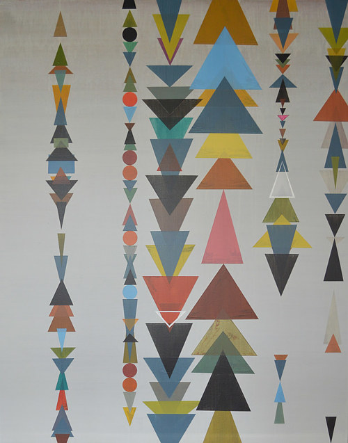 A painting with repeating, overlapping triangles