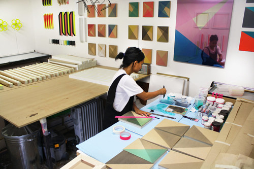 A photo of Rana Begum at work in her studio