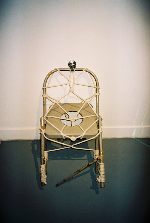 A sculpture made with a chair and some rope
