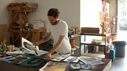 A photo of Ricky Swallow working in his studio