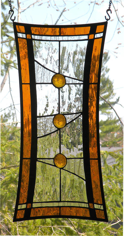 A stained glass panel with a dynamic shape