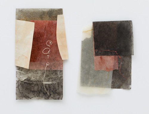 A mixed media artwork made from abstract paper layers