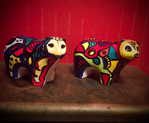 A pair of painted bear figurines