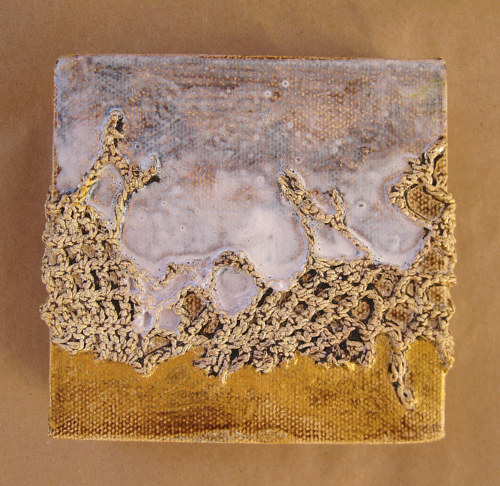 A textured abstract painting with a sandy colour