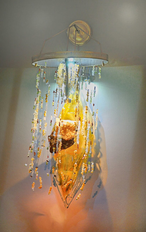 A wall-hanging chandelier made from glass and crystals