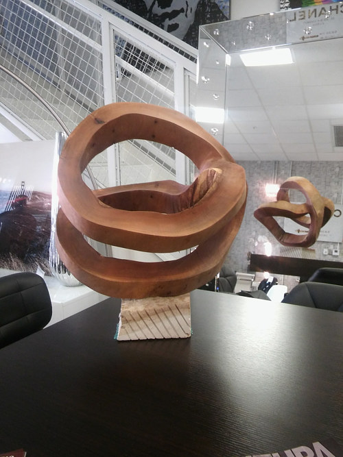 A sculpture consisting of wood rings