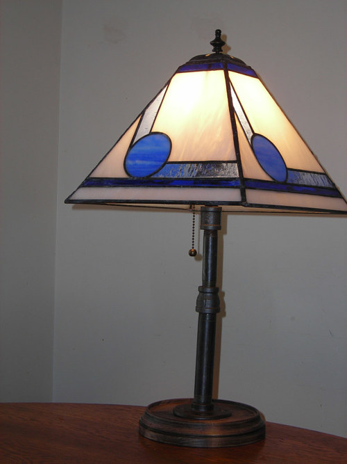 A lamp with a stained-glass shade