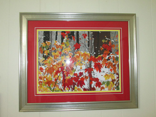 An embroidered design of autumn leaves with snow on them