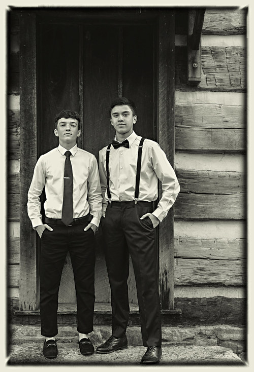 A photograph of two well-dressed young men