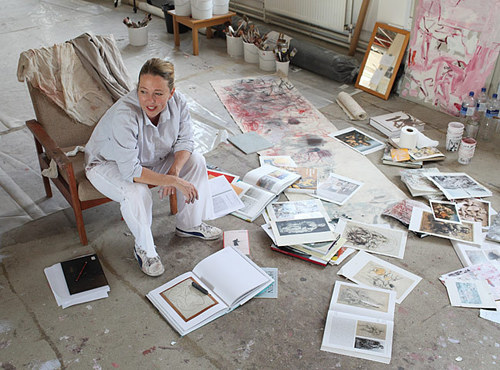 A photo of Jenny Saville at work in her studio