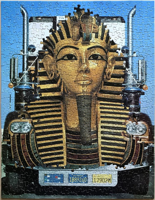 A an artwork made from two puzzles, one of a truck and the other of King Tutankhamun
