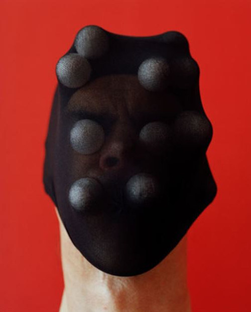 An image of a person wearing a strange nylon mask