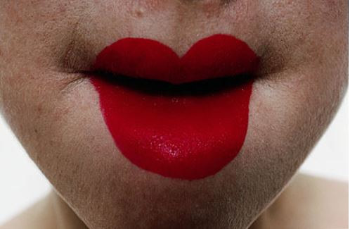 A photo of a person's lips with hugely exaggerated red lipstick