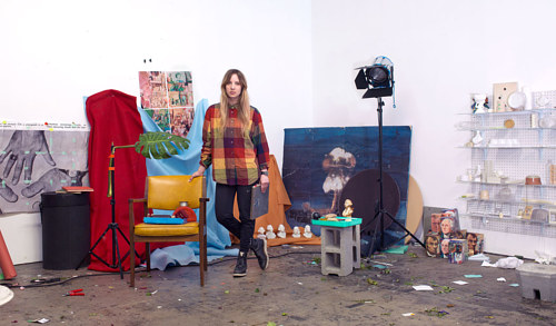 The artist Sara Cwynar posing in her art studio
