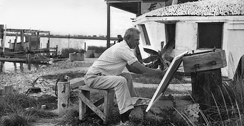 A photo of Forest Bess at work in an outdoor studio of a kind