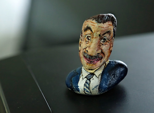 A stone painted to look like a bust of a man