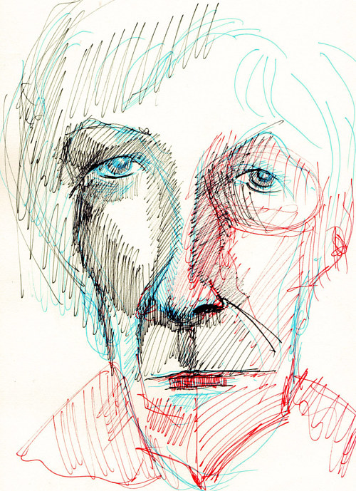 A sketch of a face in multicoloured marks