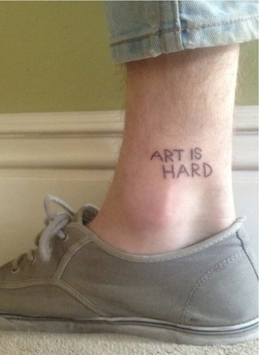 art is hard tattooed on an ankle