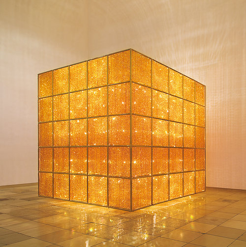 Photo of large golden cube with lights