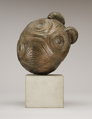 A sculpture made from bronze depicting an abstract head-like form