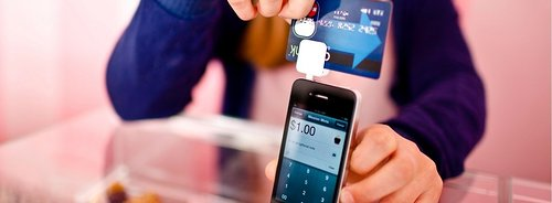 Photo of credit card swipped on a smart phone credit card scanner