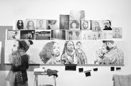 A photo of Kenturah Davis at work in her studio