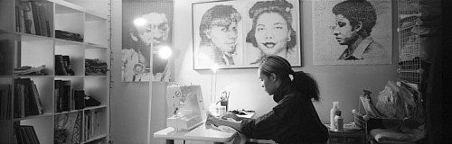 A photo of Kenturah Davis working on a textile piece in her studio