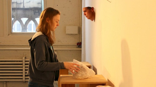 A photo of Heather Dewey-Hagborg at work in her studio