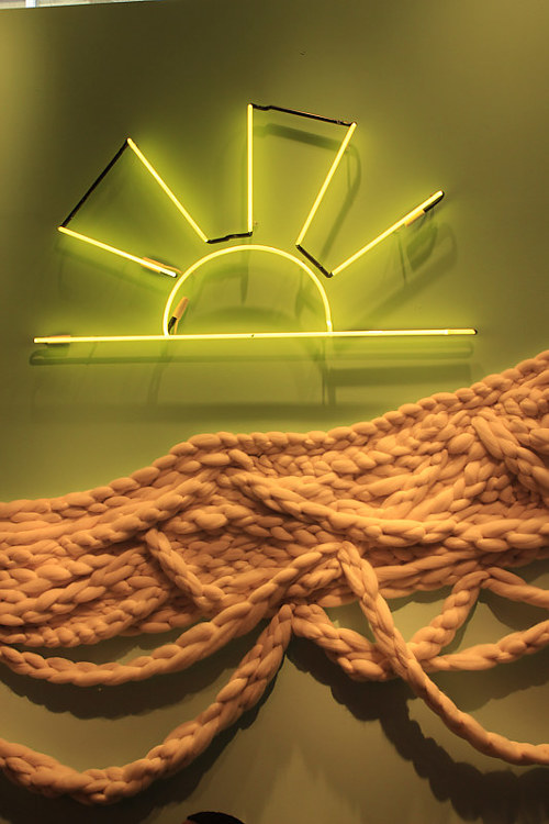 A photo of a neon sign depicting a sun