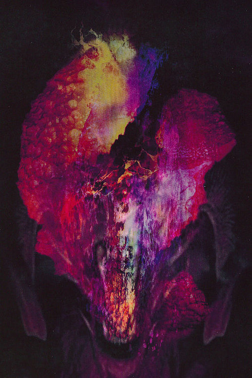 A painting made by layering poured colours over a figurative image
