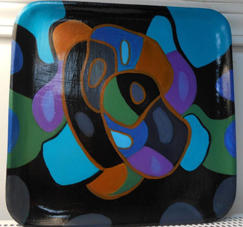 A small serving tray painted with acrylics