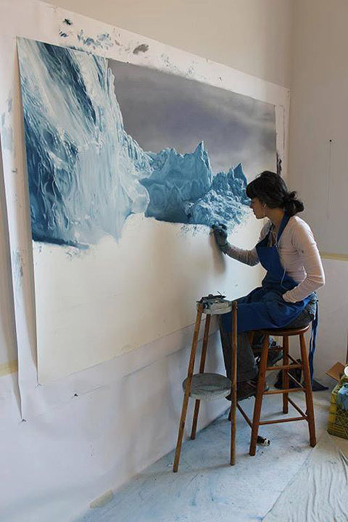 Artist Zaria Forman in her studio working with pastels