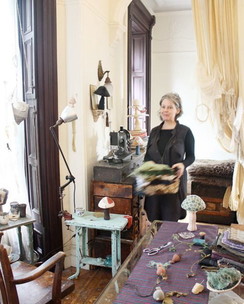 A photo of the artist Ann Wood in her home studio