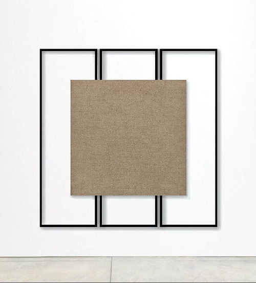A painting with a square of linen at its centre