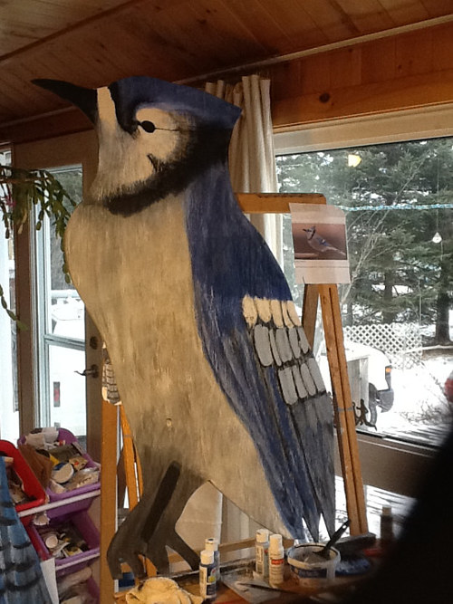 A photo of a painted bluejay carving