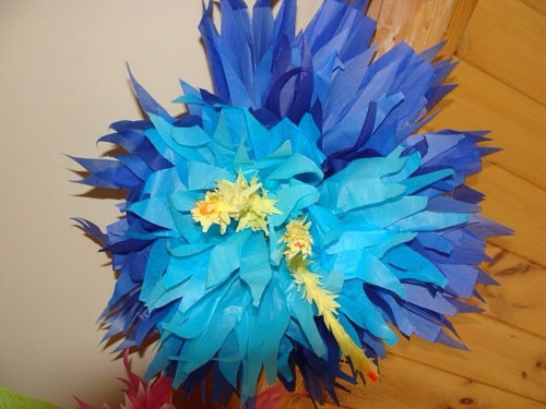 A flower made with scraps of coloured paper