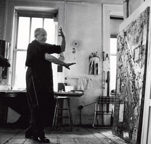 A photo of Hans Hoffman working in his studio