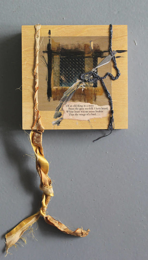A mixed media assemblage with a small piece of text