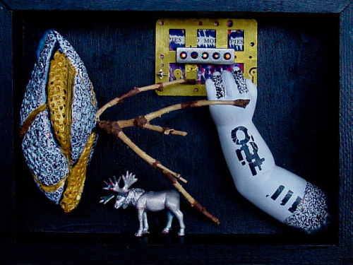 A mixed media artwork using toys and doll parts