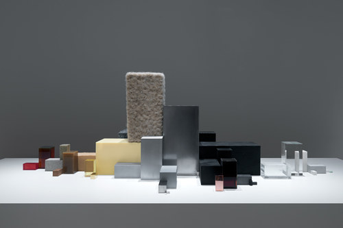 An artwork consisting of blocks of raw materials used to produce a car