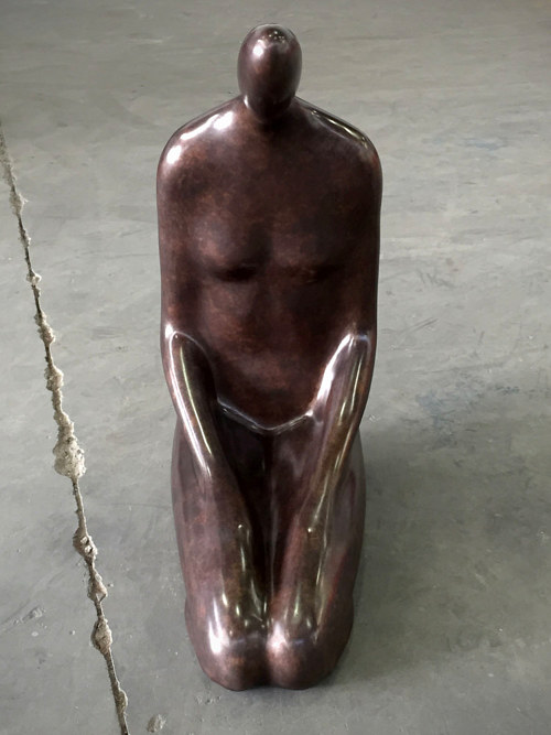 A metal sculpture of a human form