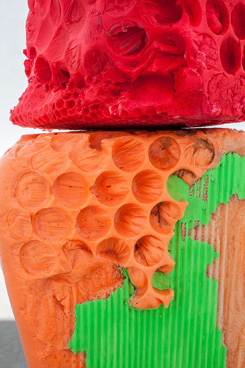 A close-up photo of a bright and colourful textured sculpture