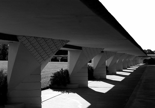 A photograph of shadows under the promenade at a university