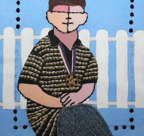 hand sewn image of a boy wearing a medal